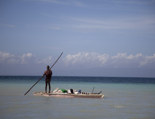 A Haitian boatsman travels from one town to the next on the island la Gonave, Haiti. 2009.